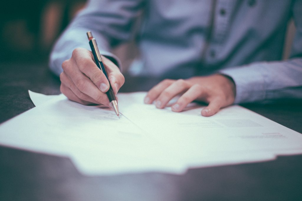 Man filling out documents