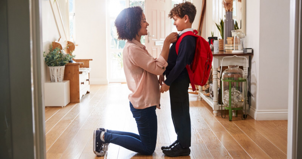 Mom getting child ready for school